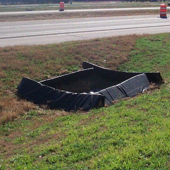 Triangular Silt Dike installed as a check dam