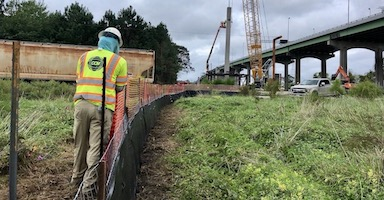 Silt fence installation for bridge project