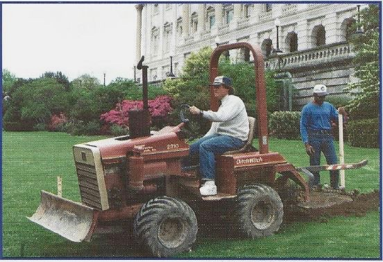 Craig Nun and Jim Ross install silt fence with trencher