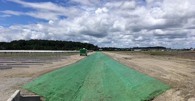 Recyclex turf reinforcement on ocean solar farm channels
