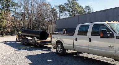 Customer picking up HDPE pipe at Colonial Construction Materials