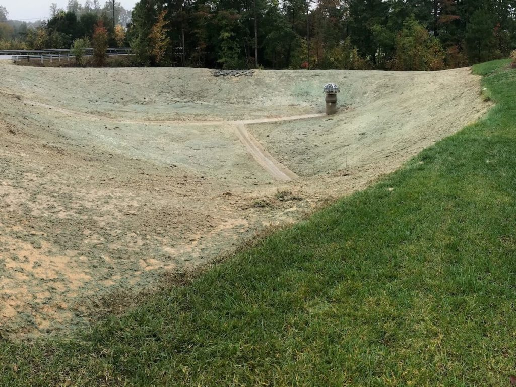 Hydroseeded pond with Earthguard hydromulch and grass seed
